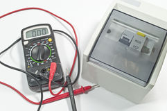 Electrical circuit Breaker & Multi-metre tester Stock Photo