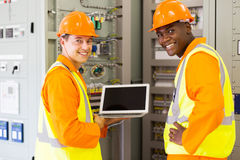 Electrical co-workers laptop computer Royalty Free Stock Photography
