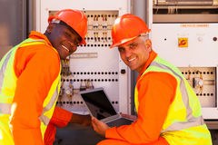Electrical co-workers laptop Royalty Free Stock Images