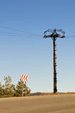 Electrical column in field under blue sky Royalty Free Stock Photos
