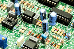 Electrical components on a control board Stock Photo