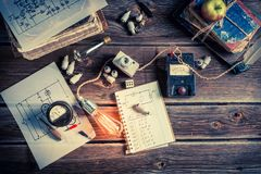 Electrical components, Edison light bulb and electrical diagram Royalty Free Stock Image