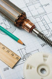 Electrical components and stationery measuring tools. Against drawings stock photography