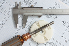 Electrical components and stationery measuring tools. Against drawings royalty free stock photo