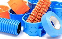 Electrical components for use in electrical installations. Orange and blue electrical boxes with components for use in electrical installations, accessories for Royalty Free Stock Photo