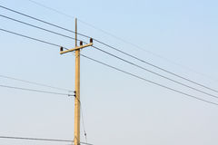 Electrical concrete post with power-lines Royalty Free Stock Images