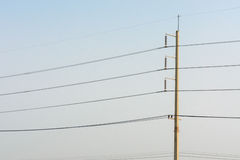 Electrical concrete post with power-lines Royalty Free Stock Image