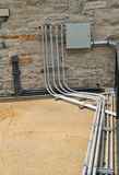 Electrical Conduit And Panel. Royalty Free Stock Photography