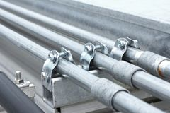 Electrical Conduit with Clamp Installation on Roof Stock Photo