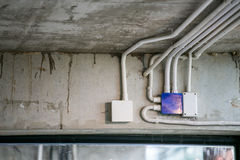 Electrical conduit. Electrical junction box with PVC conduit pipe connection stock photos