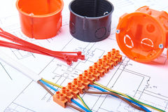 Electrical connectors with wires, junction box and different materials used for jobs in electricity. Many tools lying on   diagram Royalty Free Stock Photos