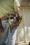 Electrical Contractor Closeup. Closeup of tool belt of an electrician stock photos