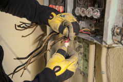 Electrical Contractor fixing panel stock photo