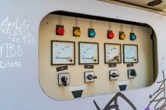 An electrical control cabinet is found on the side of the street. royalty free stock photo