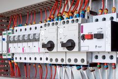 The electrical control panel are circuit breakers protecting the motor. And relay. Circuit breakers with rotary handles and push-button and arranged in a row royalty free stock image