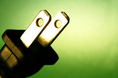 Electrical cord against green background Stock Photos