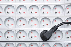 Electrical cord with power strip Stock Photos