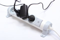 Electrical cords connected to power strip, concept of energy saving Stock Photography