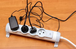 Electrical cords connected to power strip, energy saving Stock Photography
