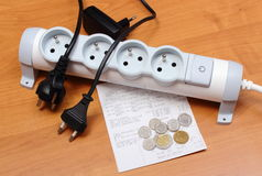Electrical cords disconnected from power strip, electricity bill Royalty Free Stock Photography