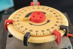 Electrical device for industrial time measurement. An old counter for switching electrical devices. Dark background royalty free stock photos