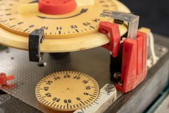 Electrical device for industrial time measurement. An old counter for switching electrical devices. Dark background royalty free stock photo