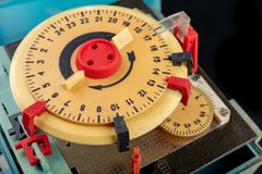 Electrical device for industrial time measurement. An old counter for switching electrical devices. Dark background royalty free stock image