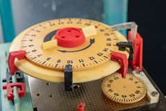 Electrical device for industrial time measurement. An old counter for switching electrical devices. Dark background stock photography
