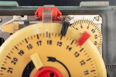 Electrical device for industrial time measurement. An old counter for switching electrical devices. Dark background stock photo