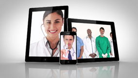 Electrical devices showing different doctors. On white background stock footage