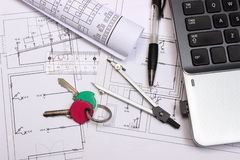 Electrical diagrams, accessories for drawing, home keys and laptop Royalty Free Stock Photos