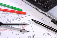 Electrical diagrams, accessories for drawing and laptop Royalty Free Stock Images