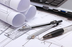 Electrical diagrams, accessories for drawing and laptop Stock Photos