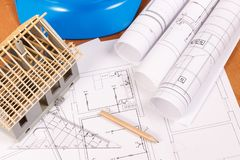 Electrical diagrams, accessories for engineer jobs and house under construction on desk, building home concept. Electrical diagrams, accessories for engineer stock photo