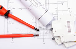 Electrical diagrams, electric fuse and screwdrivers on construction drawing of house Stock Photo