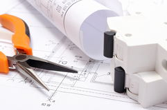 Electrical diagrams, electric fuse and work tools on construction drawing of house Stock Images