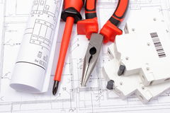 Electrical diagrams, electric fuse and work tools on drawing Royalty Free Stock Photography