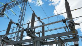 Electrical distribution station with modern equipment. View from below useful powerful electrical distribution substation with modern equipment against endless stock video