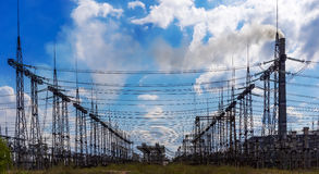 Electrical distribution station, transformers, electricity high-voltage lines Royalty Free Stock Photography