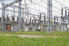 Electrical distribution station, transformers, high-voltage lines, electricity. In spring time stock photography