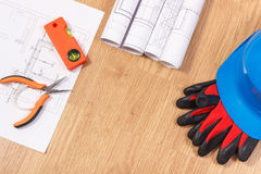 Electrical drawings or diagrams, protective helmet with gloves and orange work tools Stock Photo