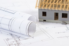 Electrical drawings, diagrams and small house under construction, concept of building home Stock Photo