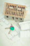 Electrical drawings, home keys and small house under construction, concept of building home Royalty Free Stock Photo