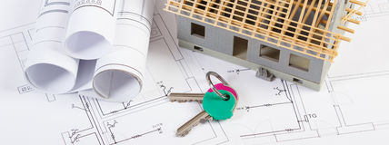 Electrical drawings, home keys and small house under construction, concept of building home Royalty Free Stock Images