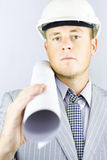 Electrical engineer carrying design blueprints Stock Photo