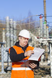 Electrical engineer with documentation. Near to the electric substations Royalty Free Stock Image