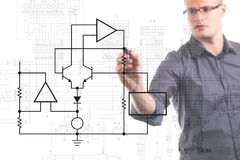 Electrical engineer drawing circuit diagram. On the whiteboard Royalty Free Stock Photo
