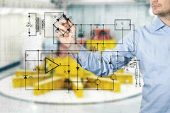 Free Electrical Engineer Draws A Diagram Of A Circuit Stock Images - 50640394