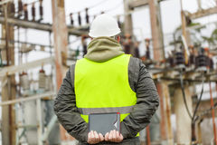 Electrical Engineer in electrical substation. In winter Royalty Free Stock Photos
