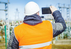 Electrical engineer filmed with tablet PC. In autum day Stock Photo